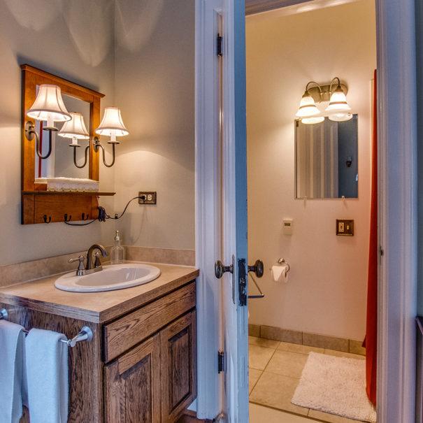 tan room white spread bathroom