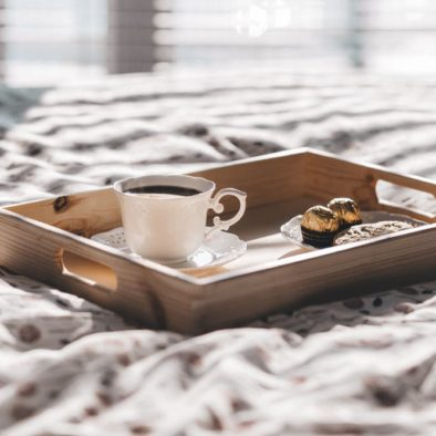 tray with coffee on bed