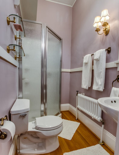 purple room with quilt bathroom
