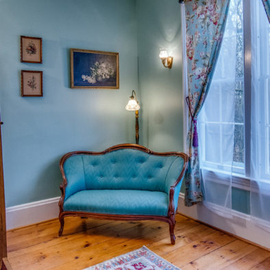 teal room with red bedspread view 3