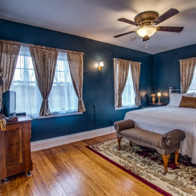 blue room with white bed spread view 1
