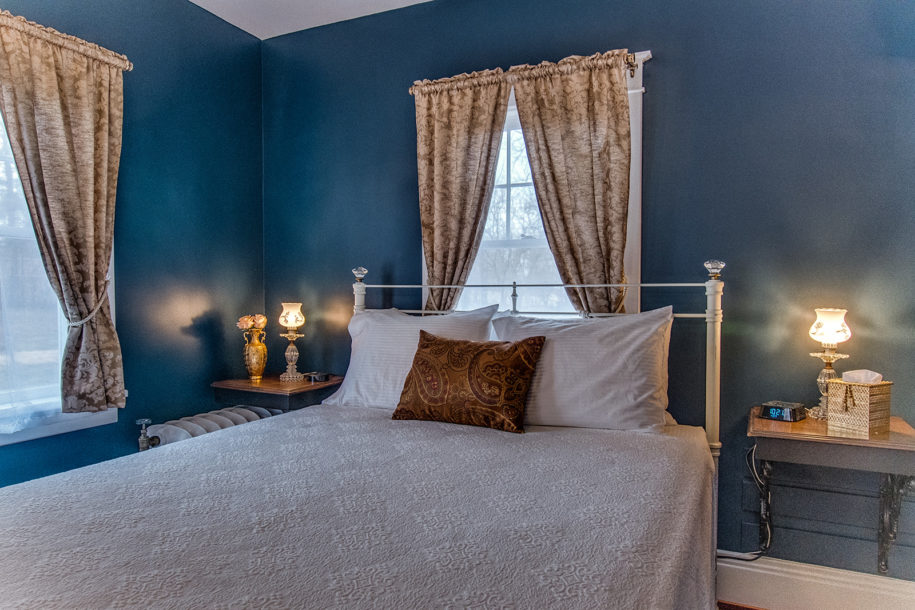 blue room with white bed spread view 3