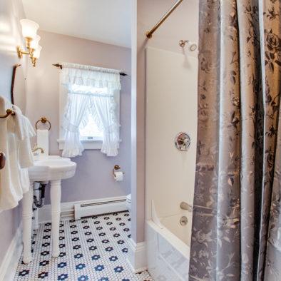 light purple room with quilt bathroom